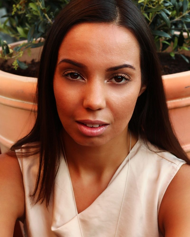 portrait mixed race woman outside for blog on money better than love