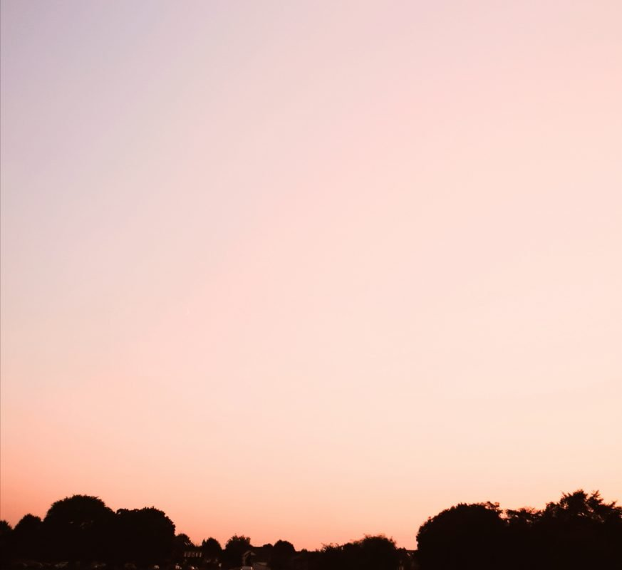 Image of pink sky for blog on how to promote eco-friendly living
