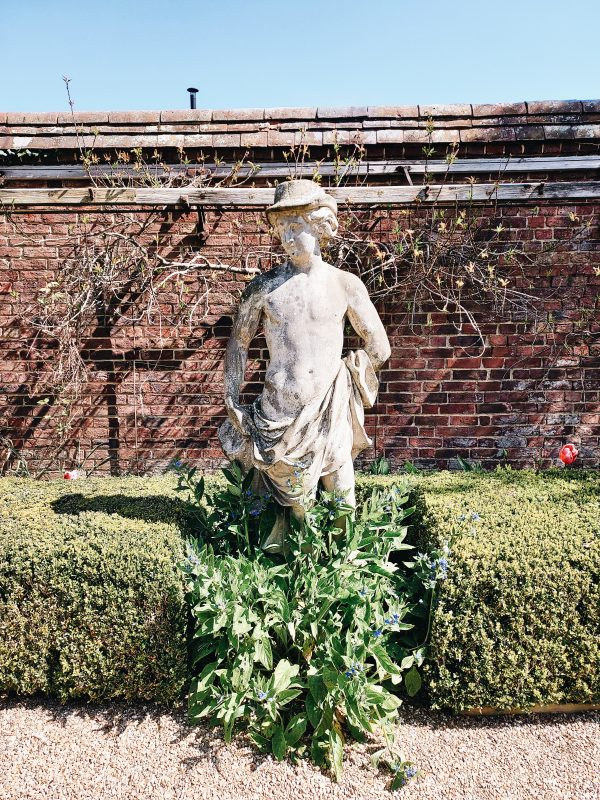Image of statue in garden for article on how to turn a conversation flirty