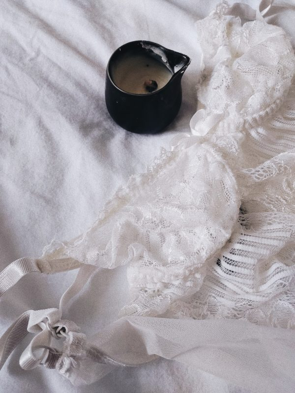 Image of massage candle and lingerie for blog on orgasm anxiety