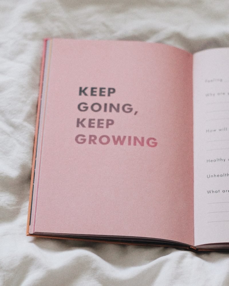 Image of book with motivational quote for post on how to feel comfortable dating again