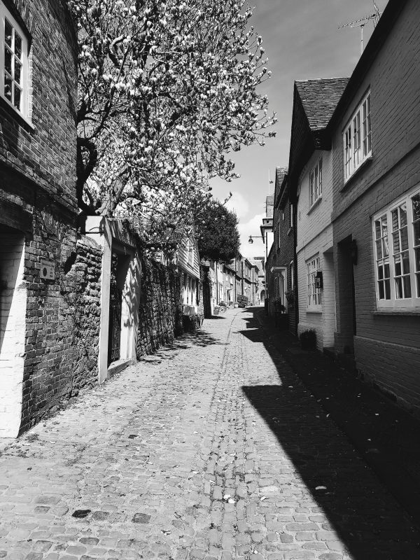 Image of black-and-white photo of lonely street for blog on when someone ghosts you