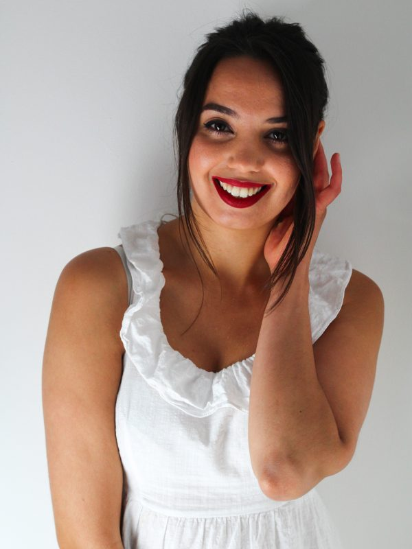 Image of girl smiling in white dress for blog on what to do when you don't like your partner's style